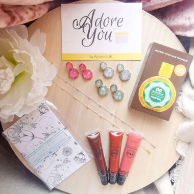 Adore You Box contends, fusion earrings x3, hair oil, lip glosses, notebook and anklets