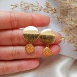 AccentsUK 18k Gold Golden Peach Earrings hand holding