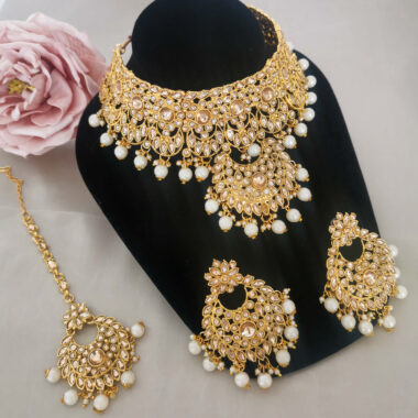 SITA – Statement Gold Necklace Tikka & Earring Set fill set on a stand picture