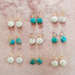 REVA - 18K Gold Plated White and Turquoise Stone Earrings with a pink crushed velvet background